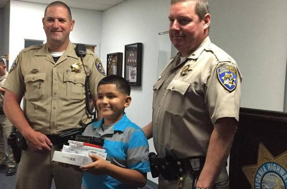 Image of 'In your face, robbers!' Modesto CHP officers replace Salida boy's stolen Nintendo